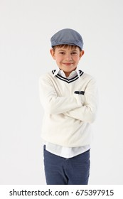 Cool little boy standing arms crossed.