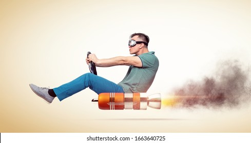 Cool man in casual clothes with goggles holds a steering wheel in his hands while driving an alternative vehicle, on yellow background.