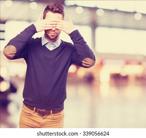 cool man covering his eyes
