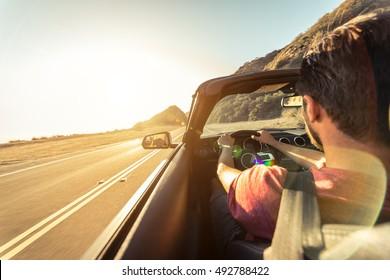 Cool man driving a sport convertible car in California