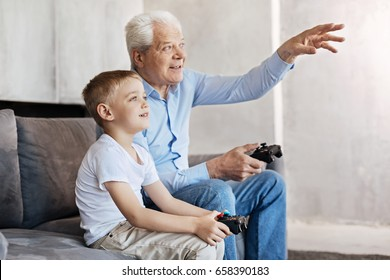 Cool man and his grandson talking about gaming