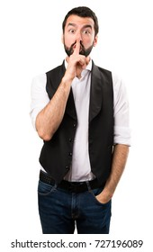 Cool man making silence gesture on isolated white background