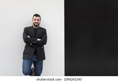 Cool man posing on white and black background