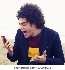 Cool man smiling reading text message