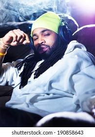 cool man smoking marijuana on his couch