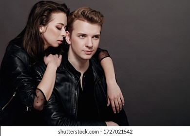 cool man and woman on gray background