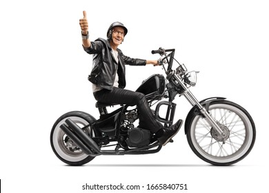 Cool mature biker in leather clothes riding a chopper and showing thumb up isolated on white background