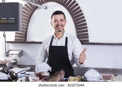 Cool mature man sells fresh fish