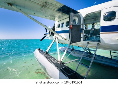 Cool old hydroplane with open door sitting on a sandy beach. Beautiful summer day in Dry Tortugas, Florida. Luxury holiday in tropical paradise. Mexical gulf holiday.