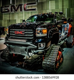 Cool picture of majesty GMC Sierra truck on caterpillar tracks ,winter truck Chicago Autoshow 02/17/2019