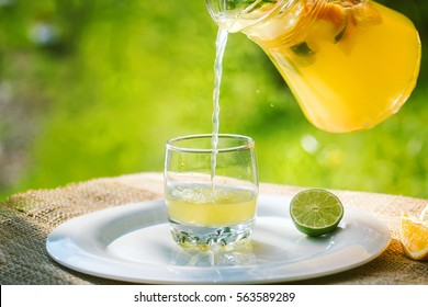 Cool refreshing drink on the background of nature and green trees