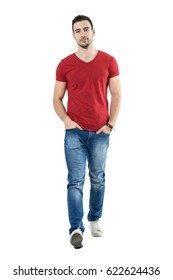 d8ad812c611 Cool relaxed casual guy with hands in pockets walking and looking at  camera. Full body