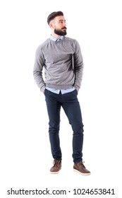 Cool relaxed modern millennial guy with notebook standing and looking away. Full body length portrait isolated on white studio background.