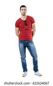 d11dbea54eb Cool relaxed young casual man with sunglasses hooked on shirt collar. Full  body length portrait