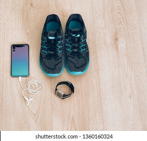 Cool runner sneakers with smartphone, earphones and fitbit sport watch. Ready for training, healthy life