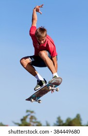 cool skateboard is jumping high in air