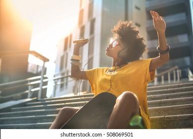 Cool skater girl dancing in the street