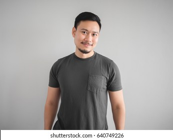 Cool smile face and pose of confidence Asian man with beard.