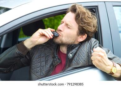 Cool smiling happy man showing key car