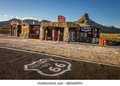 COOL SPRINGS, ARIZONA, USA - MAY 19, 2016: Rebuilt Cool Springs station in the Mojave desert on historic route 66 with the route 66 asphalt sign in front.