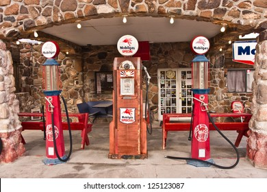 COOL SPRINGS, AZ, USA - DECEMBER 30: Old time gas pumps outside a restored service station on old Route 66 in Arizona are reminders of days gone by. Photo taken Dec. 30, 2012.
