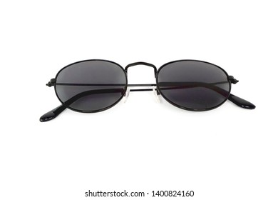 Cool sunglasses with black frame isolated on white background, top view.