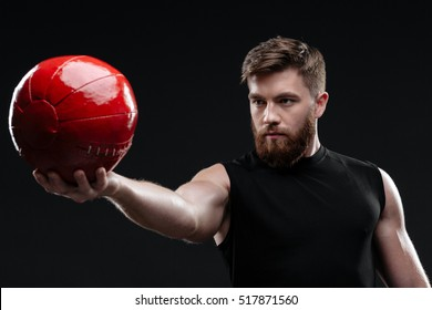 Cool trainer with ball. isolated dark background
