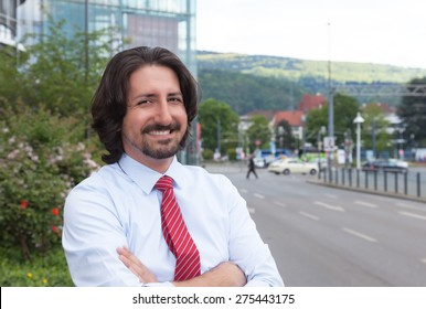 Cool turkish businessman outside in front of his office