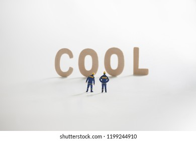 COOL word  with Miniature people: Engineer standing infront use as business concept.