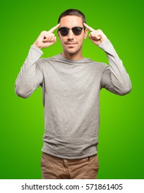 Cool young man with a concentration gesture
