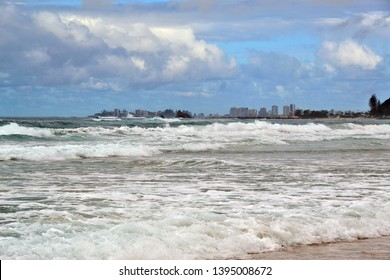 Coolangatta beach, Queensland / Australia - April 25th 2019: view onto Coolangatta in the distance from Palm Beach at the Goldcoast