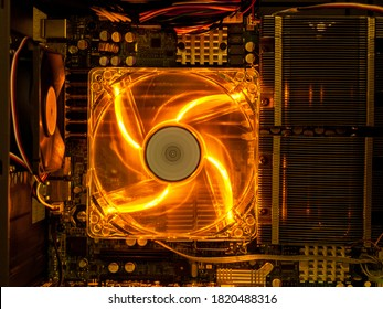 cooling fan with backlight in the computer system unit, cooling the computer air, repair and upgrade, cooling computer components - Shutterstock ID 1820488316