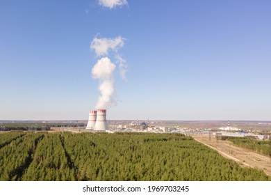 Cooling tower of Atomic power station with nuclear reactor. Industrial zone with Nuclear power plant with emission of steam in the air atmosphere.