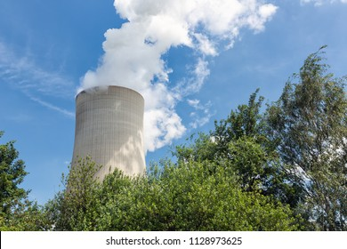 Cooling tower brown coal power plant in Germany against a blue sky