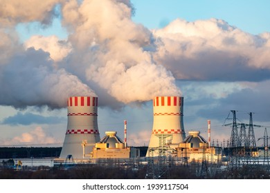 Cooling tower with steam of Atomic nuclear power station. Industrial zone of nuclear with emission of steam in the air atmosphere