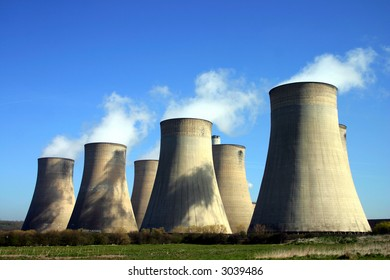 Cooling towers of a coal-fired power station against blue sky