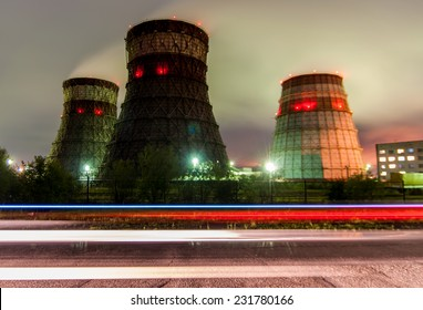 Cooling towers cogeneration - Khabarovsk, Russia in the foreground lights from a passing car