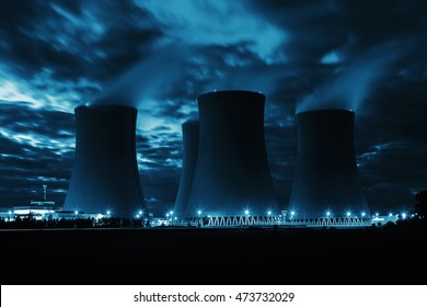 The cooling towers at night, nuclear power generation plant, Temelin, Czech Republic. Technical blue colored.