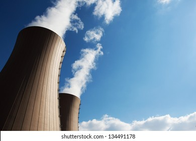 Cooling towers of nuclear power plant against the blue sky