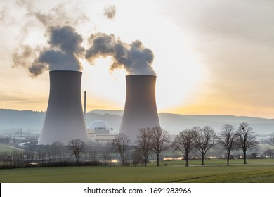Cooling towers of a nuclear power plant in the back light