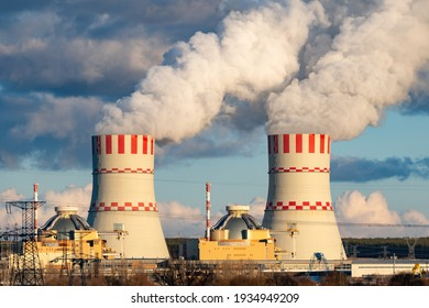 Cooling towers of Nuclear power plant emissions of steam in the air atmosphere. Industrial zone with power station atomic energy production.