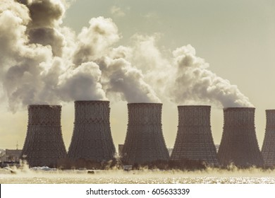Cooling towers of a Nuclear Power Plant or NPP with thick smoke, toned image. Copy space for text