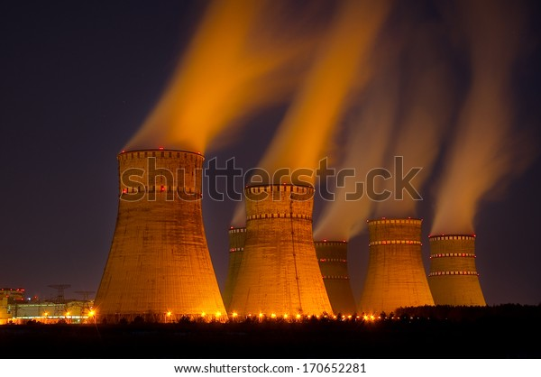 The cooling towers of the nuclear power plant at night