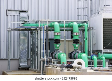 Cooling towers with piping line system in factory building.