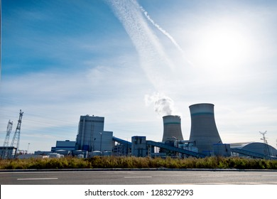 The cooling towers in a power plant.