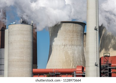 Cooling towers and smokestacks coal fired power plant near lignite mine Garzweiler in Germany