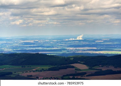 Cooling towers with steam vapour from Temelin nuclear power station in Czech Republic on cloudy day, dramatic sky