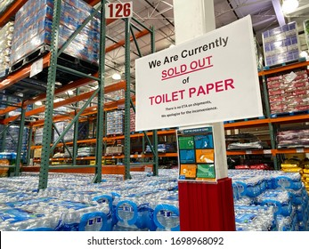 Coon Rapids, MN - April 8, 2020: Sign inside of a Costco Warehouse wholesale store lets customers know they are out of toliet paper during the COVID-19 Coronavirus outbreak pandemic
