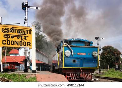 COONOOR, TAMIL NADU, INDIA, 24 October 2013 : Nilgiri mountain railway. Blue train. Narrow-gauge, steam locomotive. The train departure from the station Coonoor.