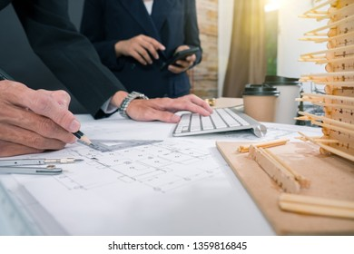 Cooperation Corporate Achievement Planning Design Draw Teamwork Concept, close-up Of Person's engineer Hand Drawing Plan On Blue Print with architect equipment.